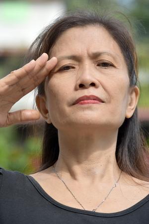 An Asian Granny Saluting