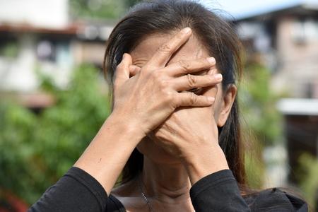 An Ashamed Female Senior Stock Photo - 115759533