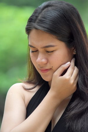 A Depressed Filipina Woman Stock Photo