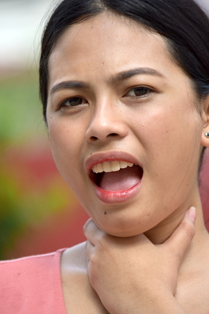 Youthful Filipina Female Choking