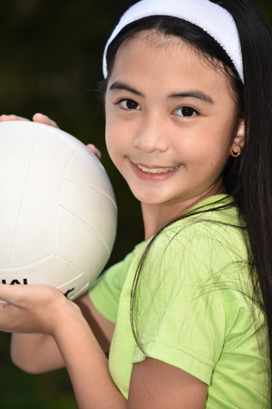 Happy Fit Filipina Person With Volleyball
