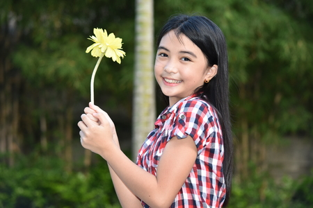 Adolescent And Happiness With Flower