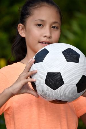 Happy Athletic Filipina Person With Soccer Ball