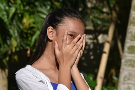 Fearful Asian Teenager Girl Stock Photo