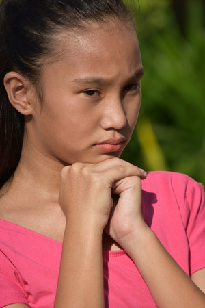 Youthful Asian Female Youngster Thinking