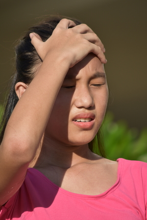 Young Asian Female With Headache