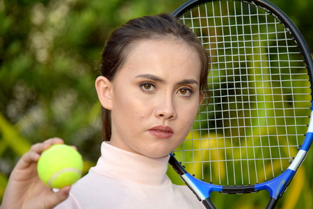 Unemotional Girl Tennis Player With Tennis Racket