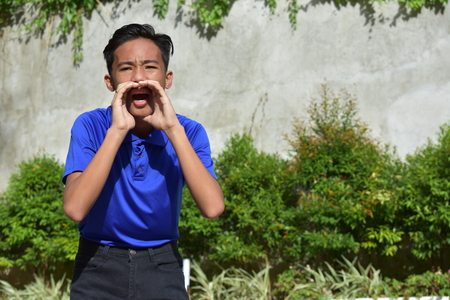 A Male Youngster Shouting Stock Photo