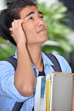 A Male Student Thinking Banco de Imagens - 116711280