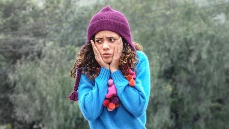 Fearful Cute Teenage Female Wearing Sweater
