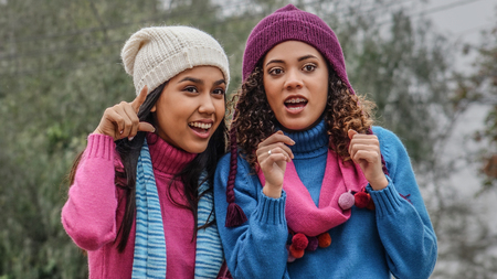 Curious Surprised Teen Girl Friends In Winter