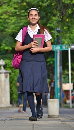 Female Student Walking To School