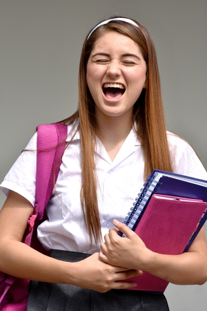 Stressful Colombian Girl Student Wearing School Uniform Stock Photo
