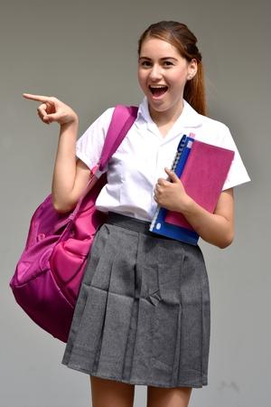 Pointing Colombian School Girl Wearing Skirt Banco de Imagens