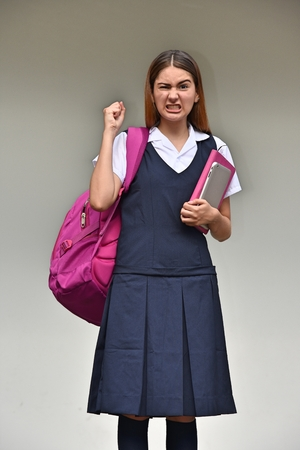 Mad Girl Student Wearing Uniform With Books Reklamní fotografie