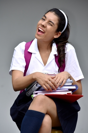 Smiling Cute Colombian Student Teenager School Girl Wearing School Uniform With Notebooks Stock Photo
