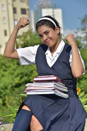 Girl Student And Muscles With Books Stock Photo