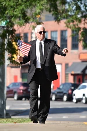 Serious Male Politician Wearing Suit And Tie Walking On Sidewalk