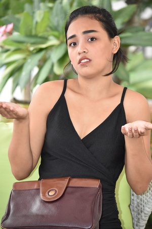 Female Making A Decision With Purse While Sitting