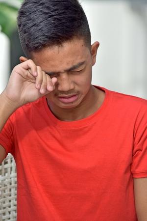 A Tearful Teen Boy Фото со стока