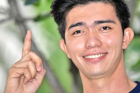 Handsome Asian Male Having An Idea