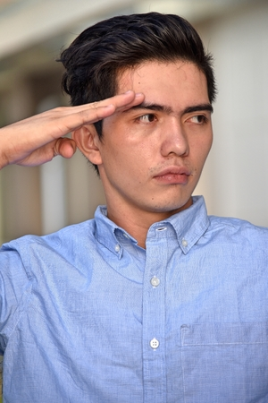 A Saluting Asian Male