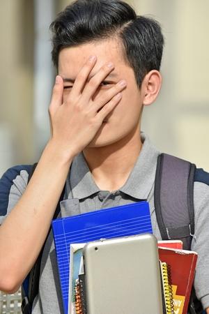 Ashamed Boy Student With Notebooks Stock Photo