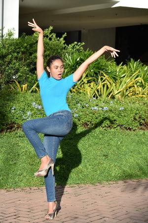 A Filipina Female Dancing