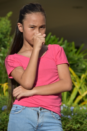 Youthful Filipina Teen Girl Coughing