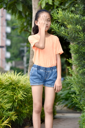 Ashamed Diverse Teenager Girl Stock Photo