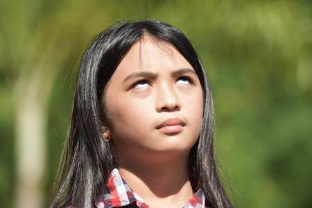 Apathetic Young Filipina Girl