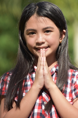 Beautiful Asian Youth In Prayer Stock Photo