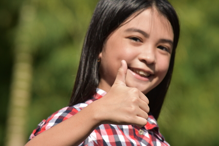 Adolescent With Thumbs Up