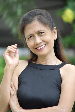 Portrait Of An Ld Minority Female Senior Foto de archivo - 117993037