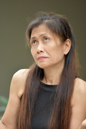 Dementia And Filipina Woman Stock Photo