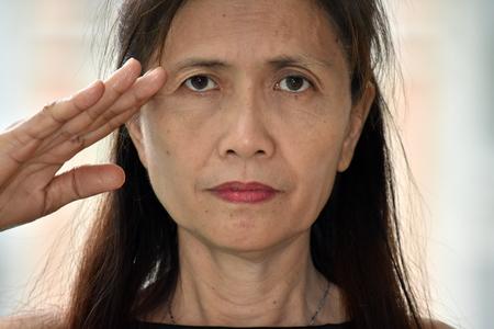 Asian Female Senior Saluting