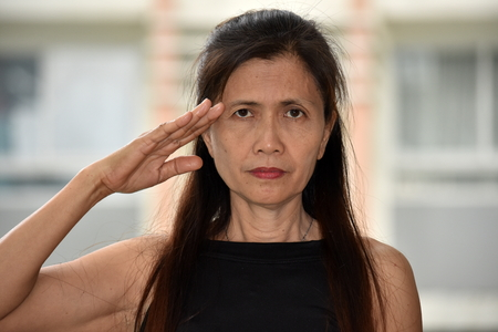 An Asian Grandmother Saluting