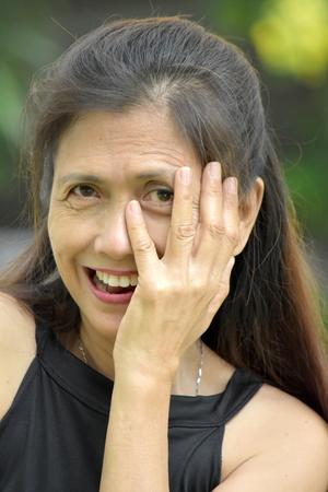Senior Minority Adult Female And Shyness