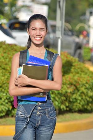 School Girl Posing With Books