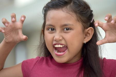 A Scary Filipina Adolescent Stock Photo