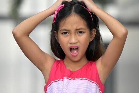 Stressed Petite Filipina Juvenile Stock Photo - 117992206