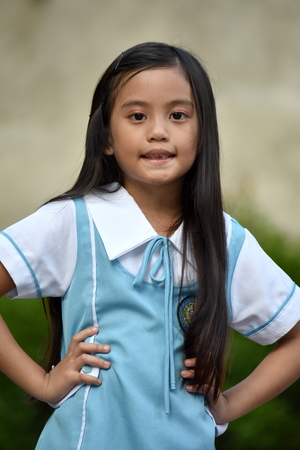 Minority Student Child With Long Hair Wearing School Uniform Stock Photo
