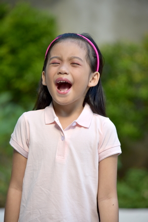 Youthful Asian Female Shouting