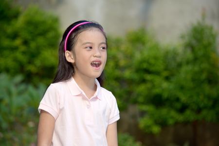 Young Asian Juvenile Talking Stockfoto