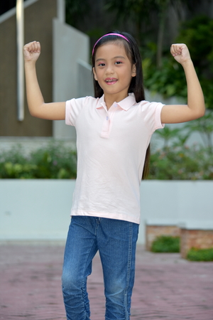 Petite Filipina Female And Muscles Stock Photo