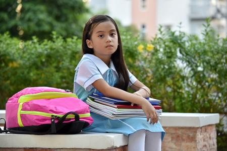 Serious School Girl Wearing School Uniform 스톡 콘텐츠
