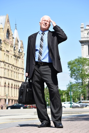 Adult Senior Investor Under Stress Wearing Suit And Tie Standing Stock Photo