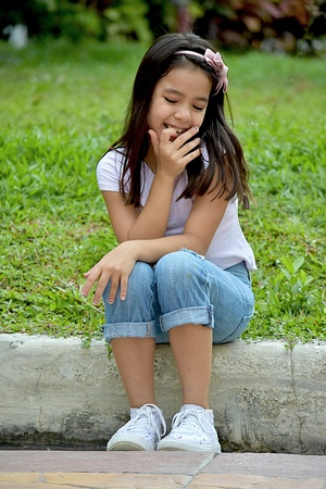 Young Asian Girl And Shyness