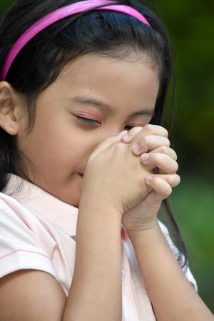 A Filipina Girl Praying Stock Photo