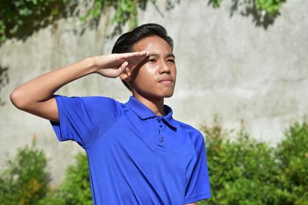 A Filipino Male Saluting
